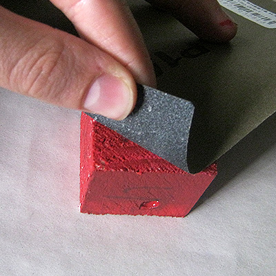 sand painted red block